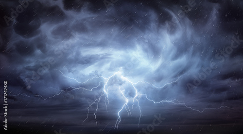 Rain And Thunderstorm In Dramatic Sky