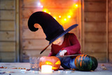 Cute little wizard with magic wand and jack-o-lanterns - 171244671