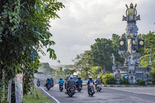 Fotobehang Bali People drive motorbikes on the street in Bali, Indonesia