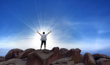 Winner man standing on the top of hill - 171256823