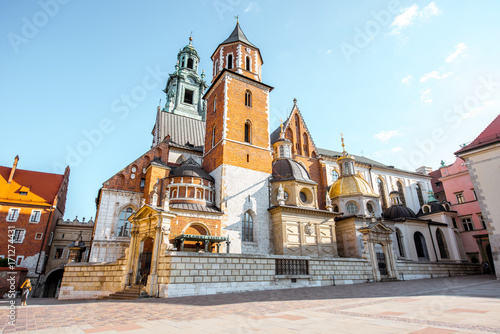 View on the inner courtyard of Wawel castle with chapels and Basilica of saint Stanislaus and Wenceslaus during the sunny morning in Krakow