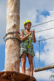 young woman in adventure park summer challenge - 171277211