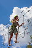 young woman in adventure park summer challenge - 171277274