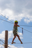 young woman in adventure park summer challenge - 171277276
