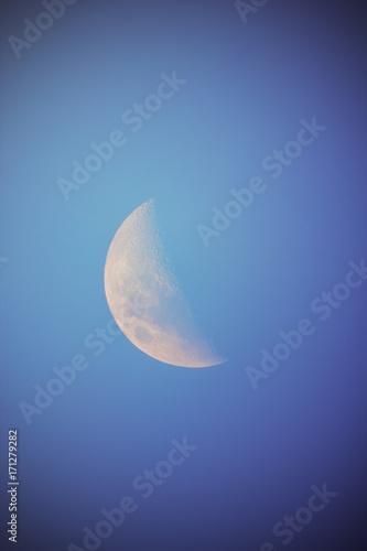 Moon on a dark-blue background.