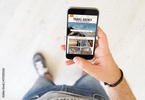 male hand travel agency smart phone