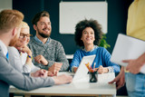 Multi ethnic team having presentation/ meeting in modern office