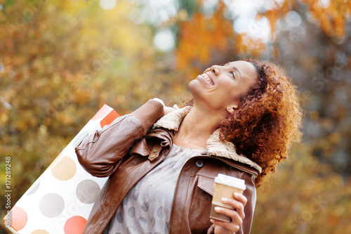 Poster Beautiful Woman Enjoyinf Shopping and Hot Drink