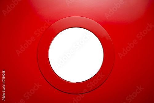 Keuken foto achterwand Schip round white porthole in the red door.Copy space