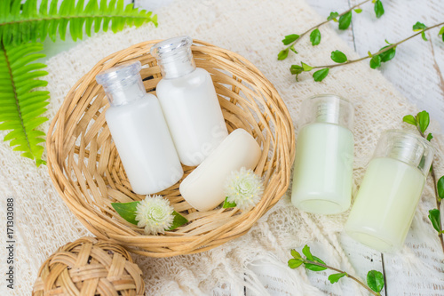Bathroom accessories. Shower gel, body lotion, shampoo on white wooden background for the bath.
