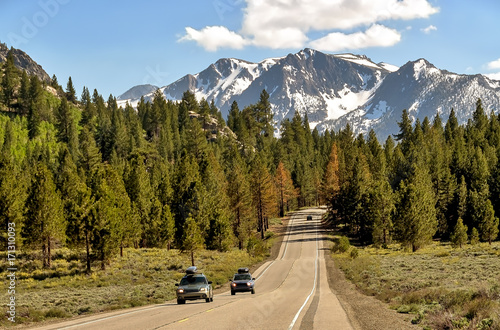 California road and Sierra Nevada landscape.