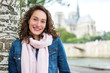 Portrait of a young tourist woman on Paris dock next to Notre Dame - Tourism and travel concept
