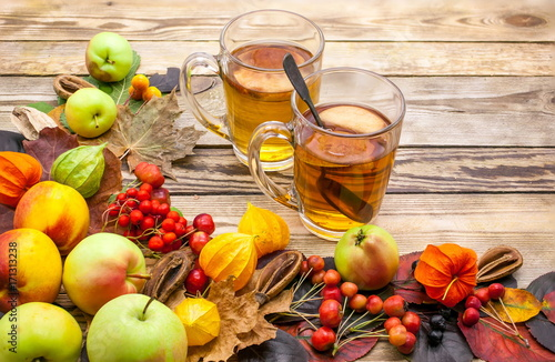 Fruit tea. Peaches, apples, berries. Autumn still life on a wooden table. Food background
