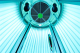 An empty solarium for sunbathing in a beauty salon or a spa with included ultraviolet lamps - 171324695