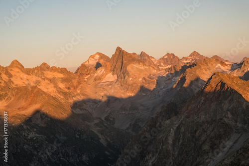 Fotobehang Grijze traf. mountain ranges with snow in the sunlight at dusk or dawn in the Caucasus