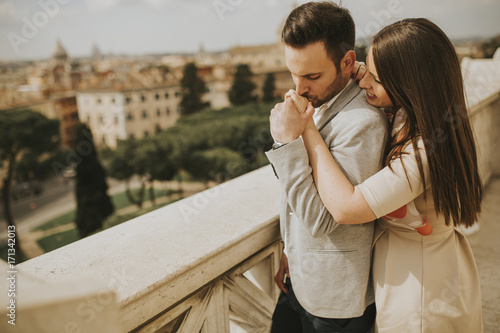 Staande foto Rome Happy loving couple, man and woman traveling on holidays in Rome, Italy