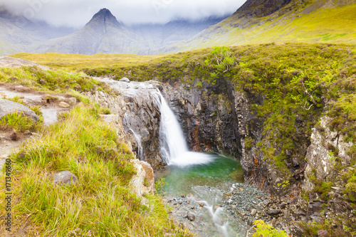 Papiers peints Miel Fairy Pools footpath with waterfall Skye island Scotland