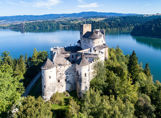 Poland. Medieval Castle in Niedzica,14th century (upper castle), Polish or Hungarian in the Past. Artificial Czorsztyn Lake and far view of the ruins of Czorsztyn castle. Aerial view in the morning