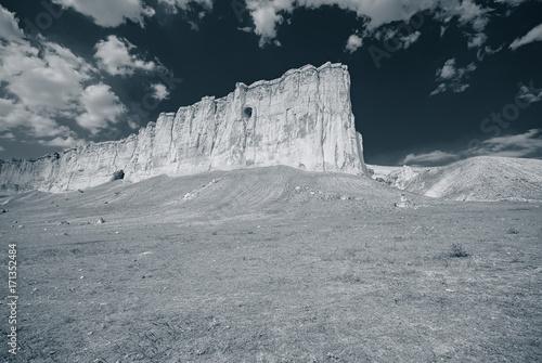 Papiers peints Taupe Mountains and sky, a landscape in a mountainous area. Monochrome photo.