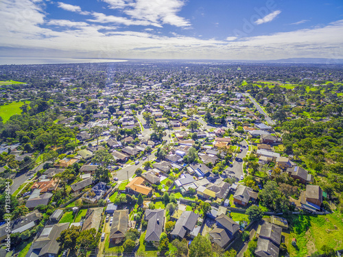 Fotobehang Khaki Aerial panorama of town houses near ocean bay on bright sunny day