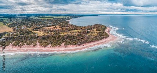 Deurstickers Groen blauw Aerial panoramic landscape of beautiful ocean coastline. Sandy beach, turquoise water and coastal vegetation