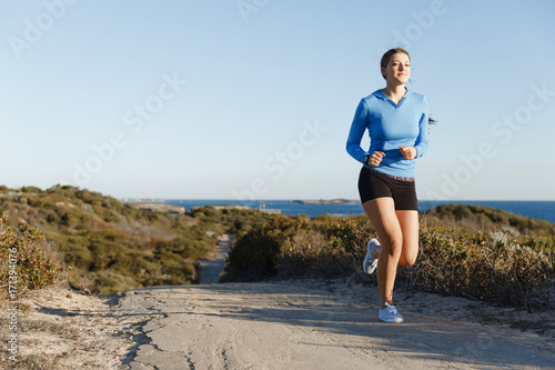 Fotobehang Fitness Sport runner jogging on beach working out