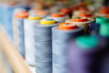 Colorful thread spools used in fabric industry - 171406660