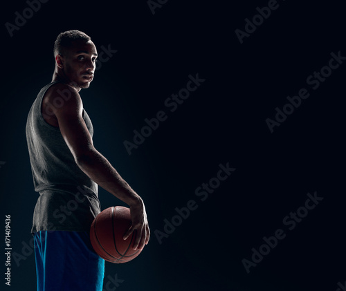 Fotobehang Basketbal The portrait of a basketball player with ball