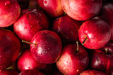 Red apples background, pile of fresh apple fruits, natural textu