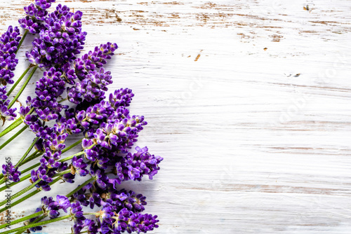 Fotobehang Lavendel Fresh flowers of lavender bouquet, top view on white wooden background