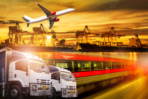 Fototapeta Logistics and transportation of container Cargo port with working logistic import and export industry with truck plane and train