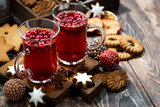 Christmas drink hot cranberry tea and cookies on dark background - 171419028
