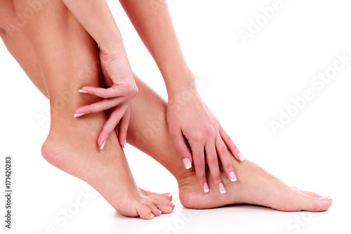 Foto op Aluminium Pedicure Woman's legs and hands, white background, isolated