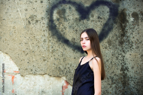 Love symbol of spray paint and girl