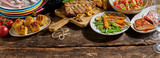 Meat, foods and dining crockery on rustic timber - 171454480
