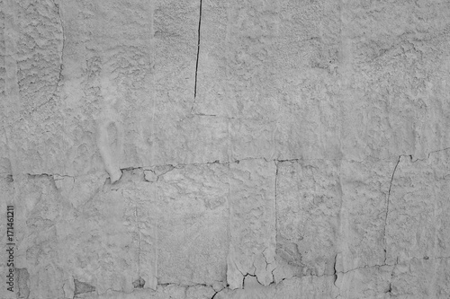 Fotobehang Stenen details of a natural stone wall on a beach