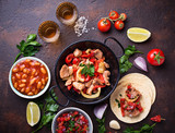 Concept of Mexican food.  Salsa, tortilla, beans, fajitas and te - 171466444