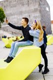 Younc couple taking selfie outdoor