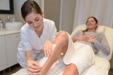 spa woman waxing her leg - 171477491