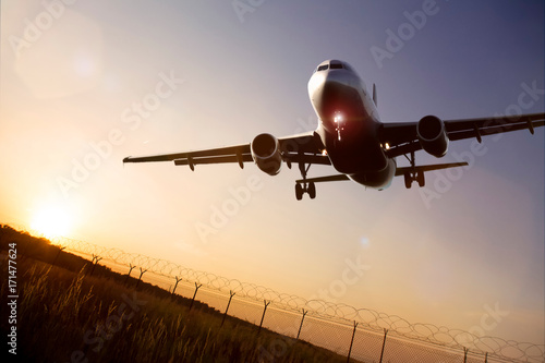 starting airplane in front of a the evening sun Poster