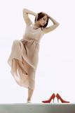 Woman in long dress elegant dress dancing