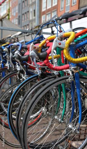 Deurstickers Amsterdam used racing bikes for sale in the flea market outdoors