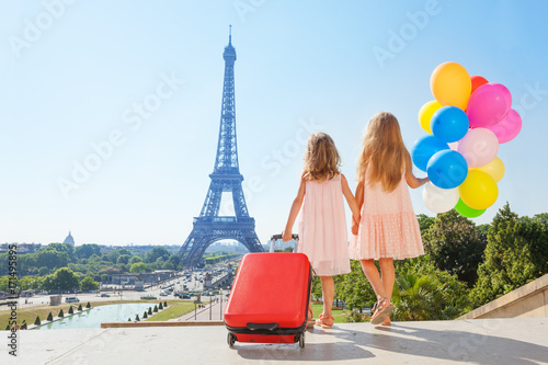 Fridge magnet Girls holding hands while walking around Paris