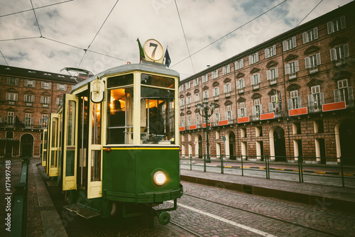 Vintage looking image of an historical tram waiting for passengers in Piazza Cas Poster