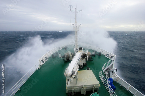 Foto op Canvas Antarctica Ship's Bow diving into a big splashing wave, antarctic ocean, Antarctica