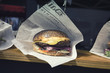 roleta: Fresh Burger Wrapped Up in Newspaper on Stall Display in London Borough Market