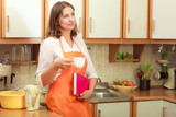 Female cook relaxing in kitchen. - 171523238