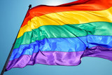 Rainbow flag on clear sky symbol of tolerance and acceptance - 171529275