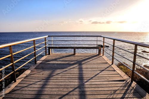 Foto op Plexiglas Zee zonsondergang The Sun Setting in the Sea