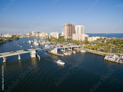 Boat passing drawbridge in Fort Lauderdale, Florida. Aerial view.